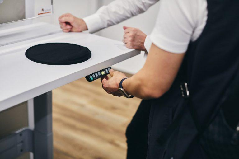 Adjusting controller on desk