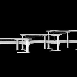 Three white corner sit-stand desks with under desk cable management