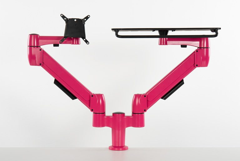 Double SpaceArm monitors arms in bespoke pink colour with VESA mount and laptop platform