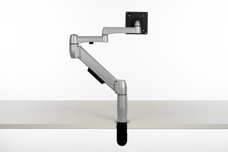 Platinum SpaceArm monitor arm with extension piece for a longer monitor arm mounted to desk