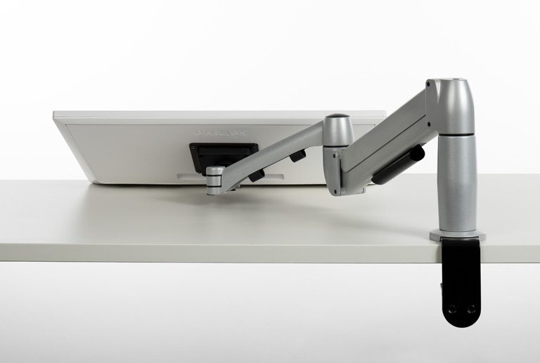 Reverse of Flyt monitor arm for touchscreen monitors positioned flat on a desk