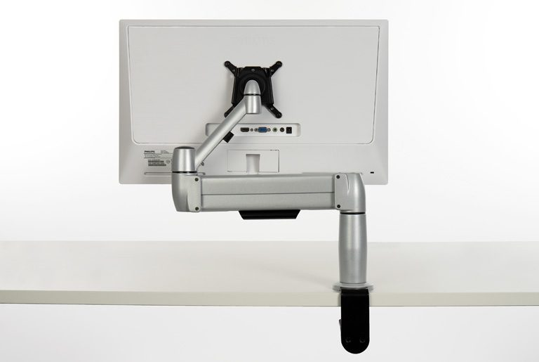 Single SpaceArm monitor Arm from the back, mounted directly to a desk
