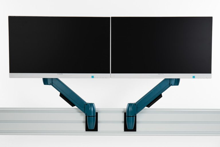 Two SpaceArm monitor arms in bespoke blue colour fixed to SpaceBeam tool rail